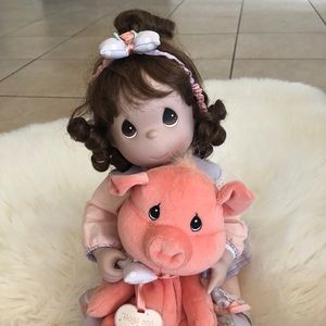 Precious Moments porcelain doll with animal (pig)